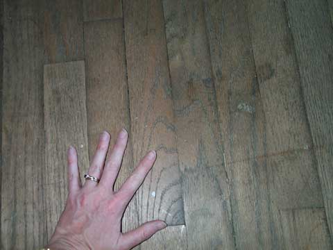 [The unfinished oak floors]