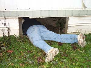 [photo of me crawling under the trailer house]