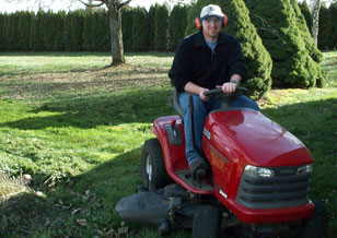 [Jeff, mowing with his beloved lawn tractor]